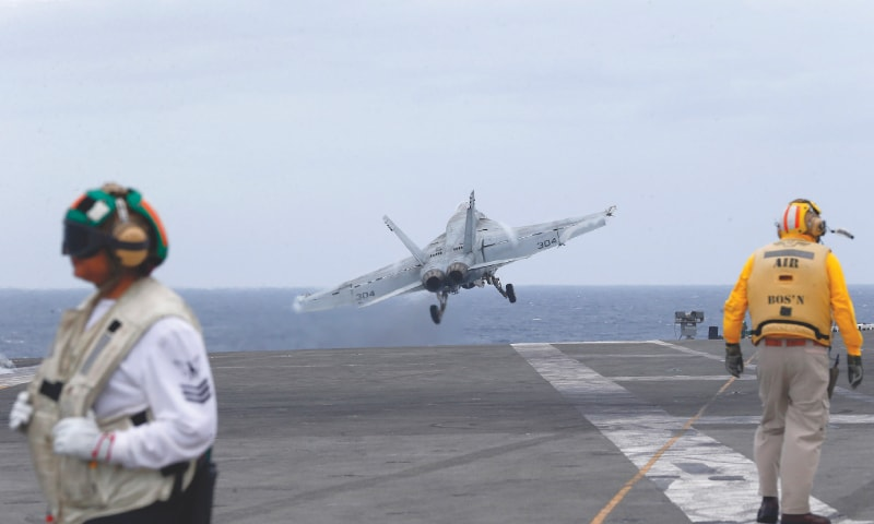 A US fighter jet takes off from the aircraft carrier, USS Ronald Reagan,  for patrol in international waters off South China Sea on Tuesday. — AP
