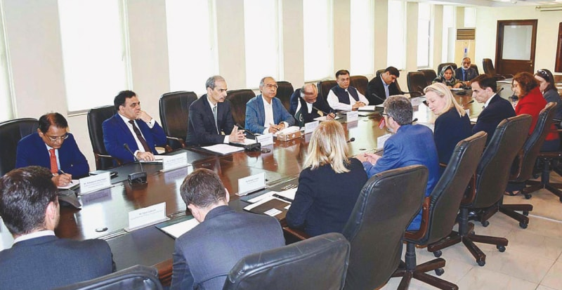 ISLAMABAD: Prime Minister's Adviser on Finance and Revenue Dr Abdul Hafeez Shaikh and his team holding talks with a US delegation led by Alice Wells.—APP