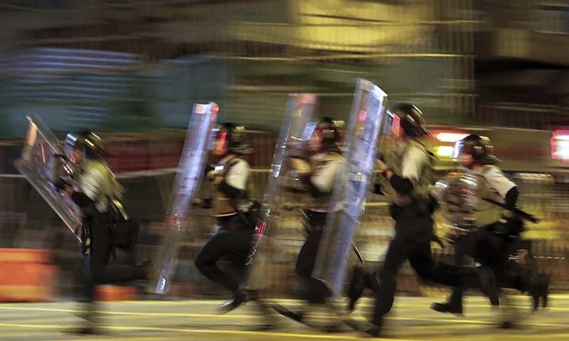 Beijing warns HK protesters not to 'play with fire'