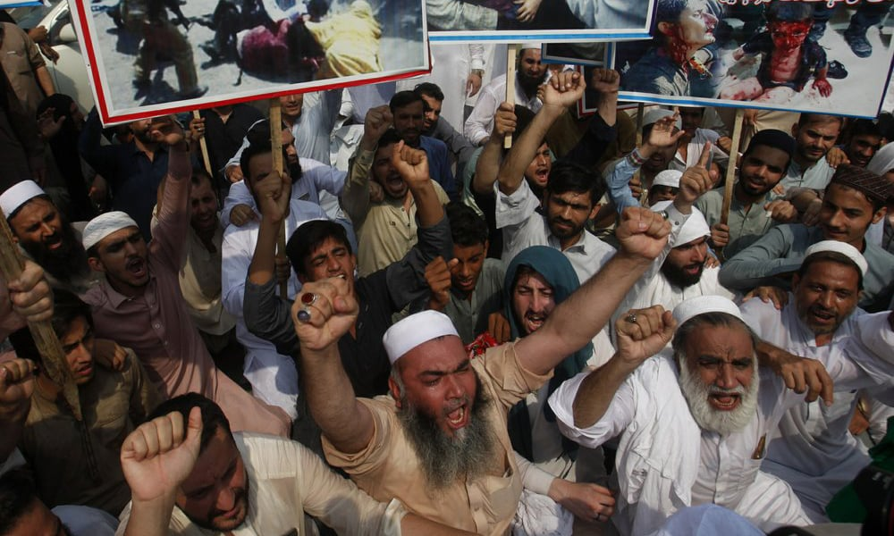 People attend a rally to protest India's policy on Kashmir, in Peshawar, on Tuesday. — AP