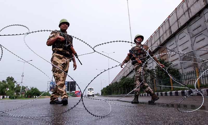 Security personnel stand guard at a roadblock in Jammu on Wednesday, August 7. — AFP