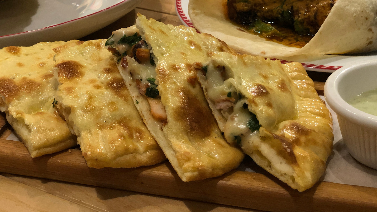 The chicken cheese naan was oozing with cheese