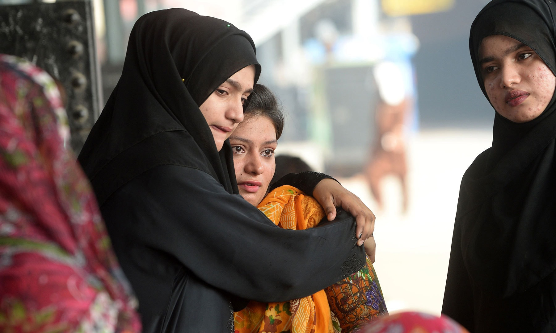 A Pakistani woman (L) embraces her Indian relative (C) ahead of her departure to India via the Samjhota Express train, also called the Friendship Express that runs between Delhi and Attari in India and Lahore in Pakistan, at the railway station in Lahore on August 8, 2019. — AFP