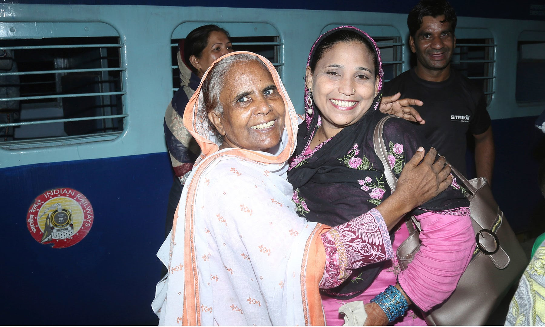 Passengers arrive from India at Lahore railway station in Pakistan, Aug 8, 2019. — AP