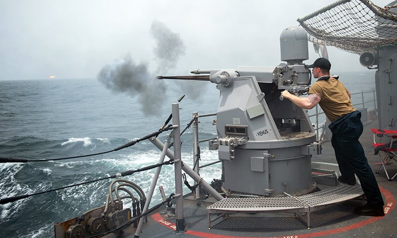 A gunner fires a Mark 38 25 mm machine gun system during a live-fire exercise aboard the guided-missile cruiser USS Leyte Gulf (CG 55) in the Gulf, in this undated handout picture released by US Navy on August 1. — Reuters