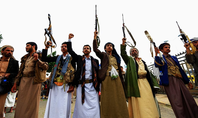 Tribal gunmen loyal to the Yemeni Huthi movement take part in a rally against the ongoing Saudi-led military coalition blockade in the capital Sanaa on August 9, 2019. — AFP