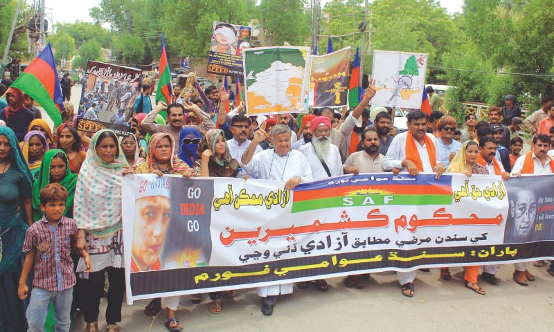 AN all-faith rally organised by the Sindh Awami Forum to condemn Indian move to annex Kashmir passes through a street of Hyderabad on Friday.—Online