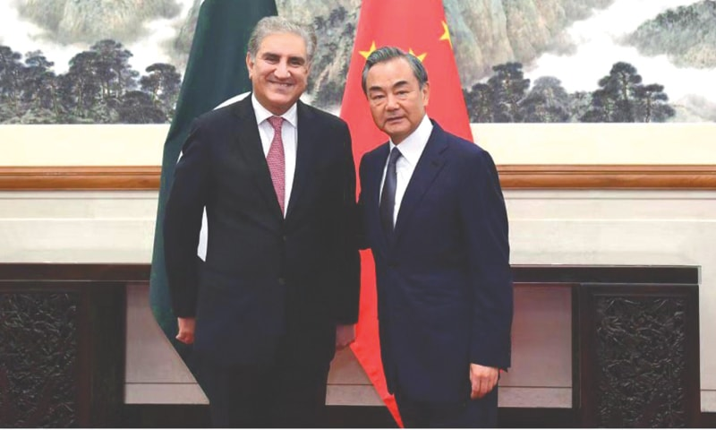 BEIJING: Chinese Foreign Minister Wang Yi receiving Foreign Minister Shah Mehmood Qureshi at the State Guest House on Friday.—APP