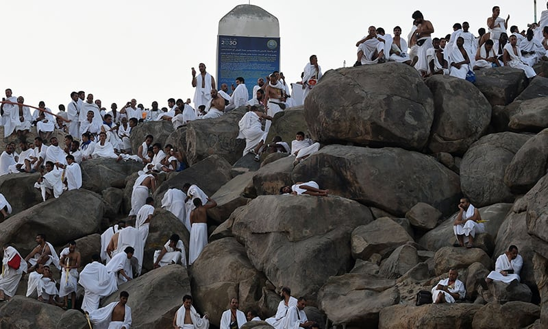 Pilgrims pray at Mount Arafat on Saturday. — AFP