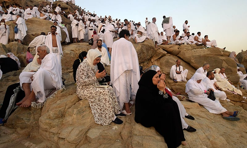Pilgrims pray at Mount Arafat, also known as Jabal al-Rahma (Mount of Mercy), southeast of the Saudi holy city of Makkah, as the climax of the Haj pilgrimage approaches on Saturday. — AFP