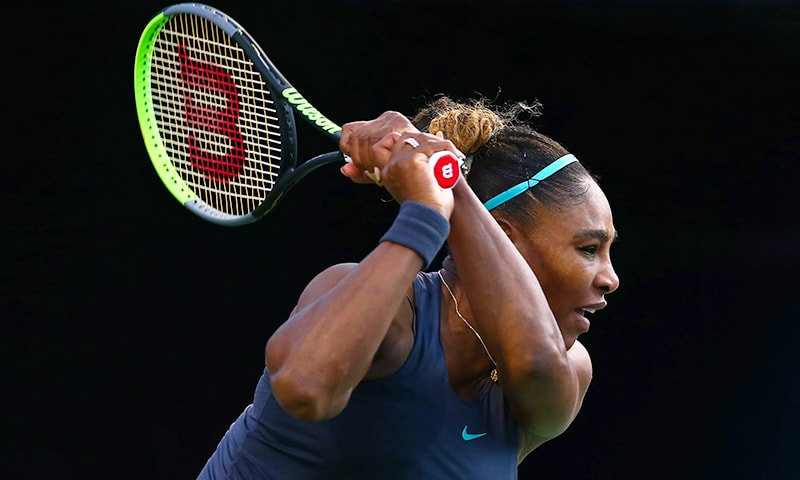Serena Williams of the United States hits a shot against Naomi Osaka of Japan during a quarterfinal match on Day 7 of the Rogers Cup at Aviva Centre on Saturday  in Toronto, Canada.   — AFP