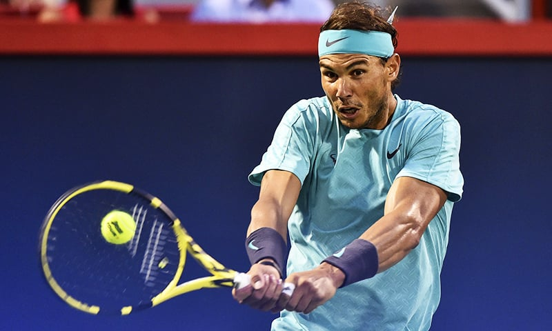 Rafael Nadal of Spain hits the ball against Fabio Fognini of Italy during day 8 of the Rogers Cup at IGA Stadium on Friday in Montreal, Quebec, Canada.  — AFP