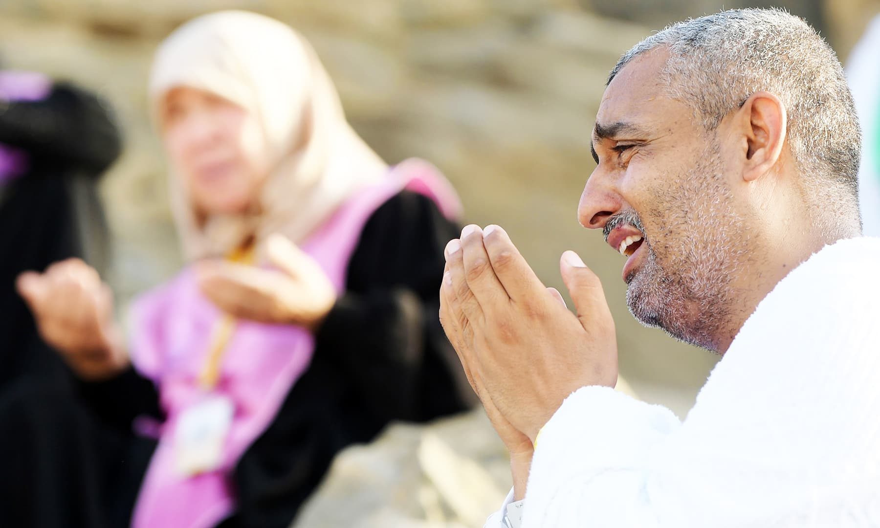 Pilgrims pray at Mount Arafat, also known as Jabal al-Rahma (Mount of Mercy). — AFP