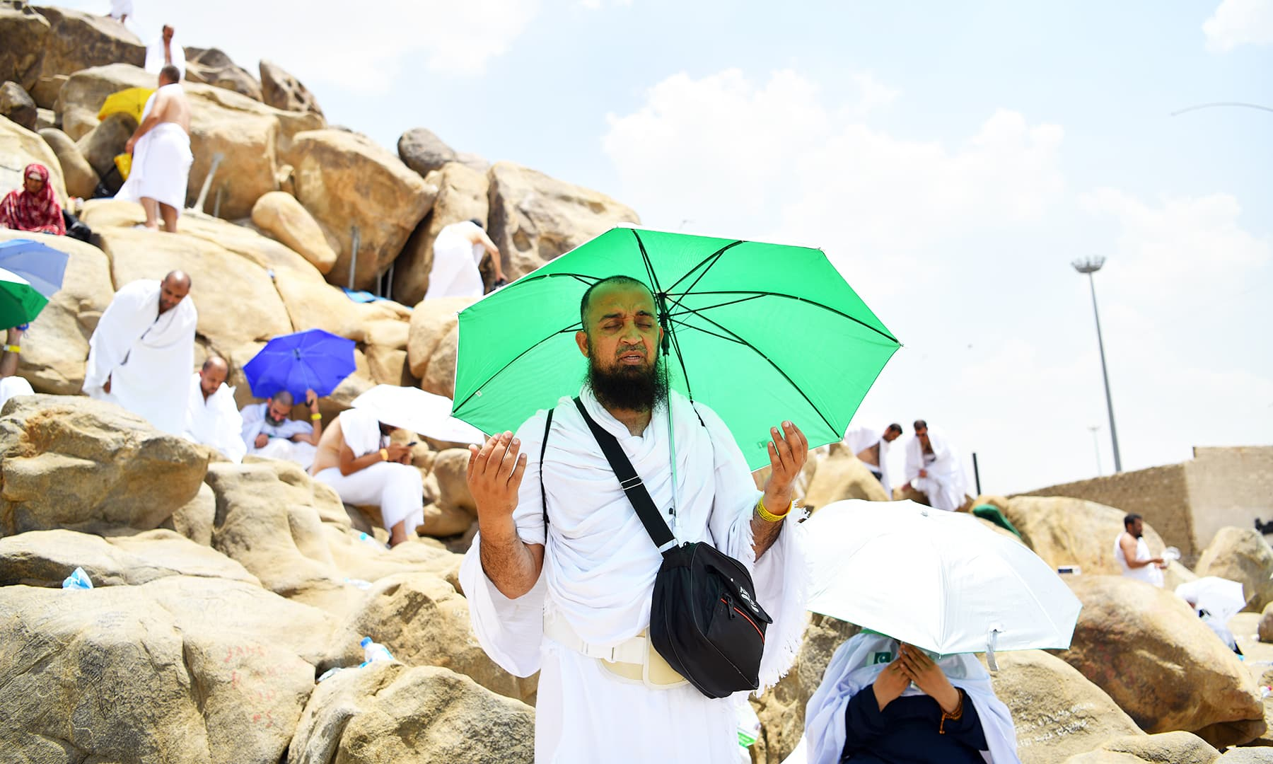 A pilgrim prays on Mount of Mercy in Arafat ahead of the Eidul Azha festival in the holy city of Makkah. — Reuters