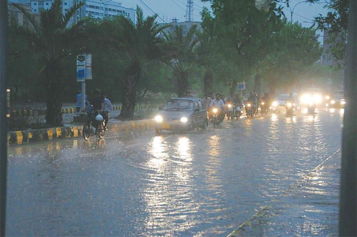 A MAIN thoroughfare in Hyderabad inundated in rainwater after several long spells of showers on Saturday.—Dawn