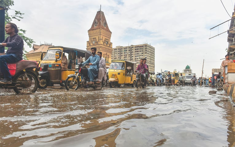 PARTS of Saddar, including the area near St Patrick's Cathedral and Empress Market, are inundated on Saturday.—Fahim Siddiqi/White Star