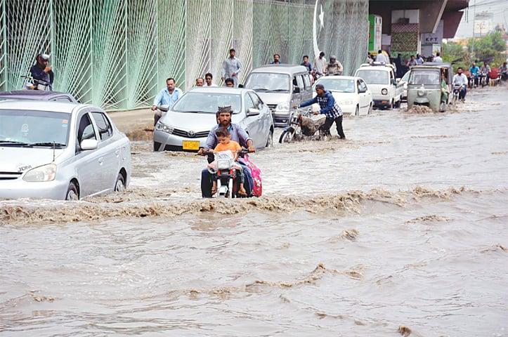Motorists navigate rainwater on a city road on Saturday.— PPI