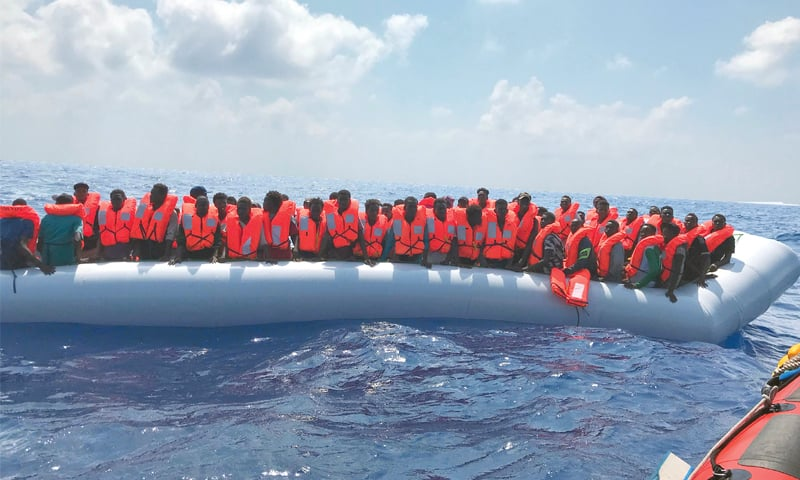 Migrants stand on an inflatable boat during the second rescue operation in the Mediterranean Sea on Saturday.—AFP