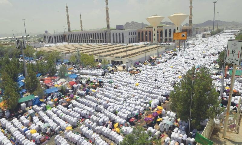 PILGRIMS pray at Mount Arafat during Haj on Saturday.—AFP