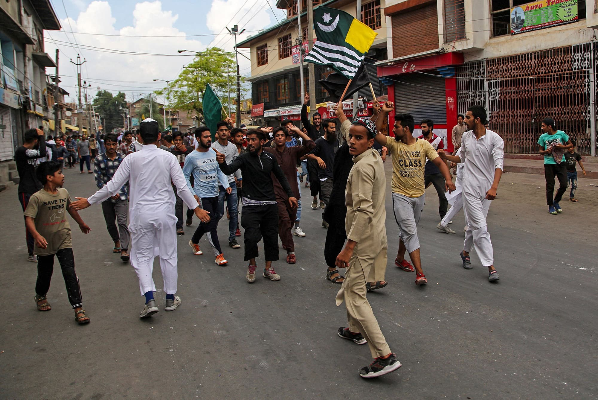 Kashmiris shout pro-freedom slogans during a protest in Srinagar under curfew. ─ AFP