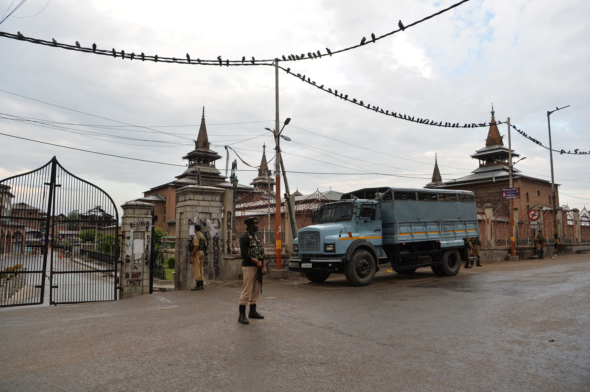 Security personnel stand guard on a street in Srinagar. ─ AFP