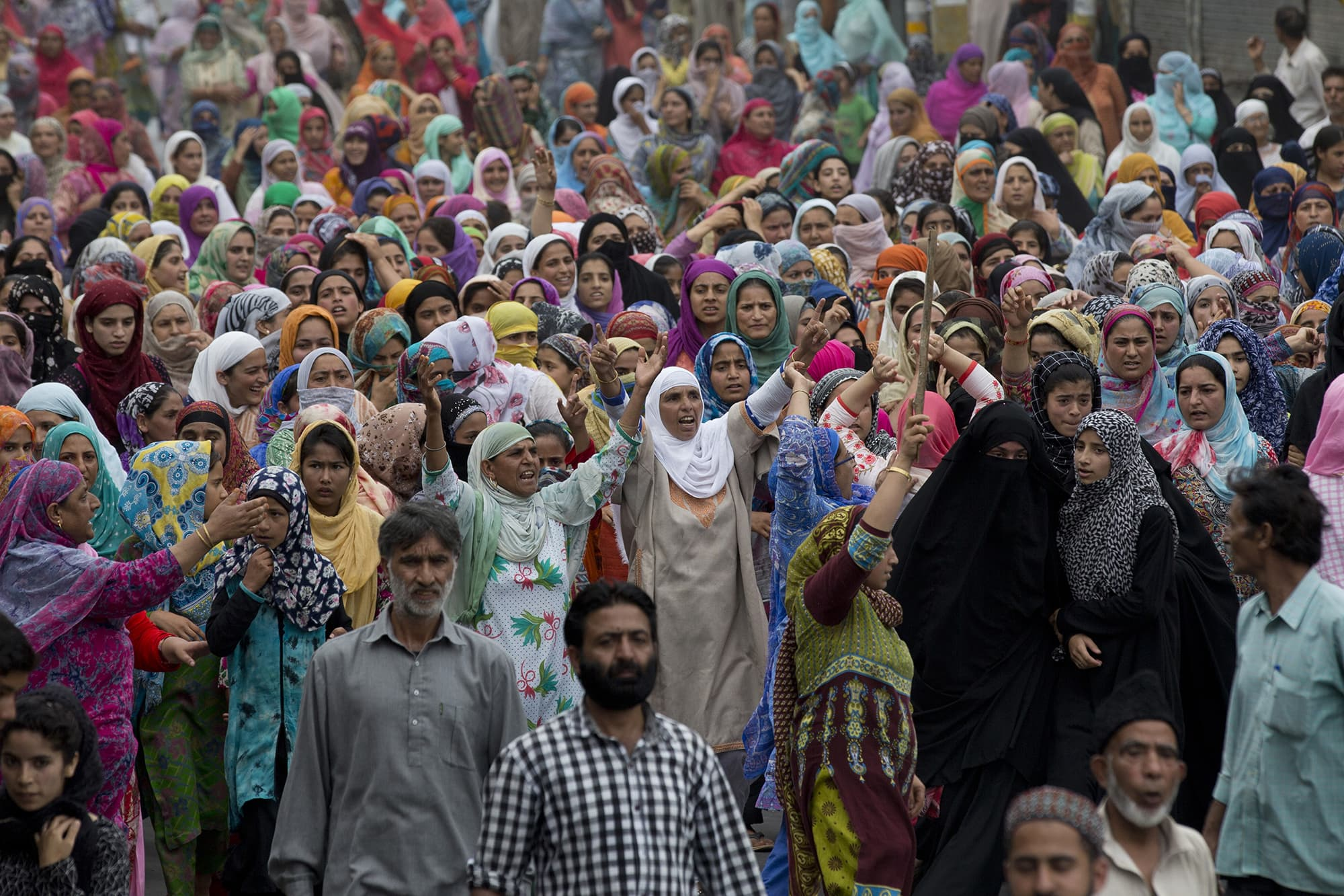 Kashmiri women shout slogans during a protest march held under curfew in Srinagar. ─ AP