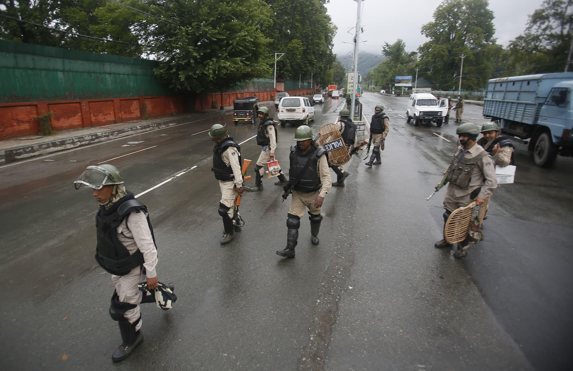 Indian security officers patrol a street in Srinagar. ─ AP