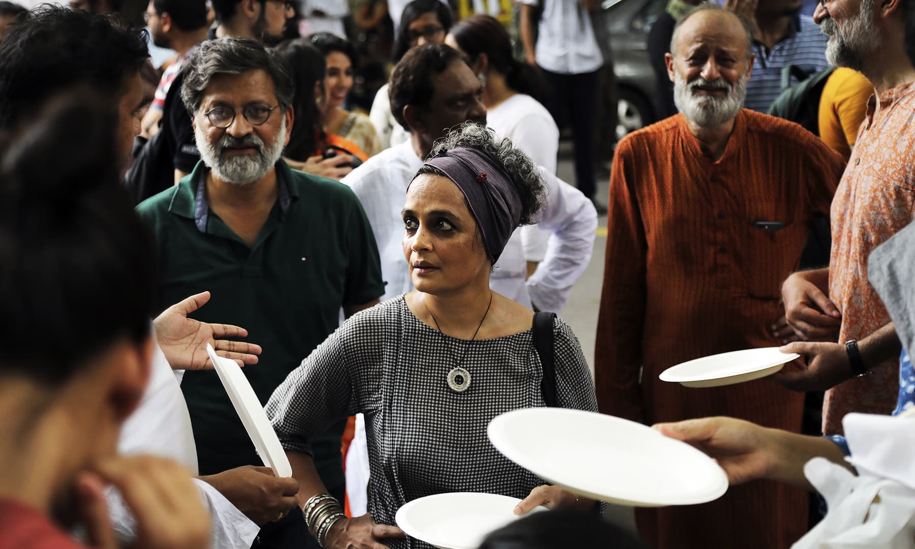 Award winner author Arundhati Roy, center, participates in a gathering of Kashmiri people residing in India.— AP