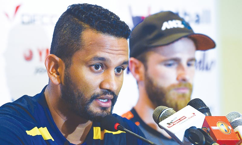 GALLE: Sri Lankan captain Dimuth Karunaratne speaks as his New Zealand counterpart Kane Williamson looks on during a joint press conference at the Galle International Cricket Stadium on Tuesday. — AFP