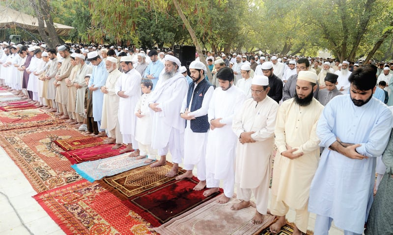 People offer Eidul Azha prayers at the Eidgah on Charsadda Road, Peshawar, on Monday. — White Star