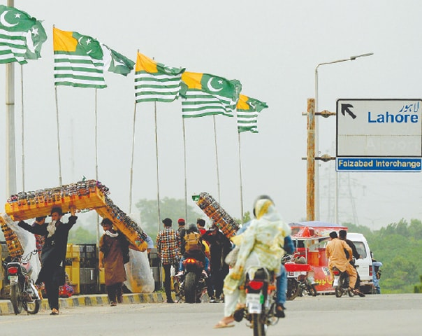 Islamabad: Flags of Azad Jammu and Kashmir flutter here on Tuesday.—Mohammad Asim / White Star