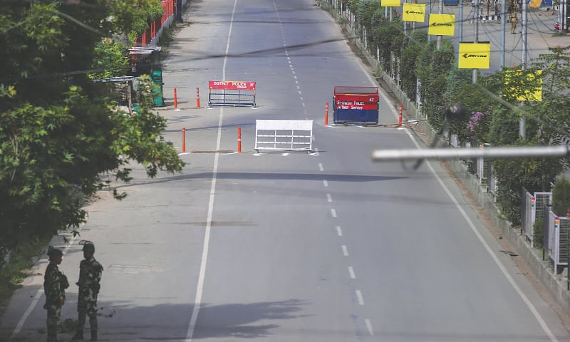 Srinagar: Indian soldiers stand guard on a deserted road during restrictions on Eidul Azha. — Reuters
