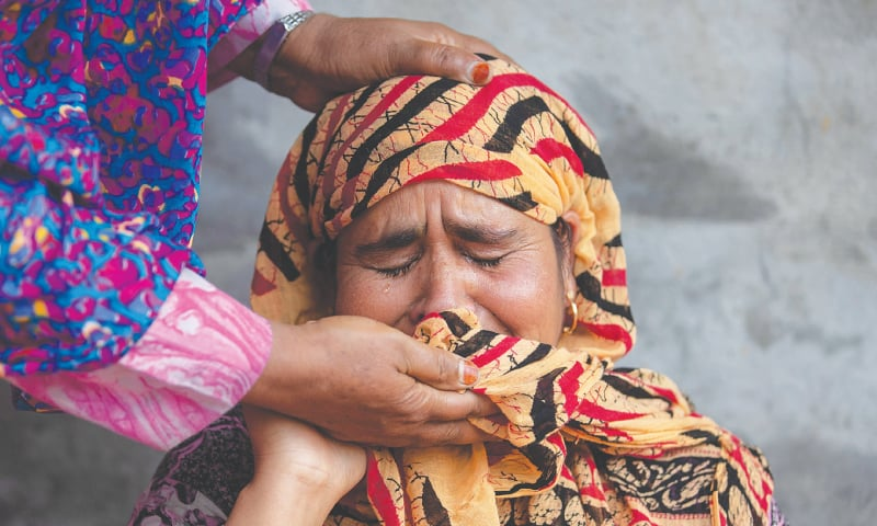 Pulwama: Jameela, mother of Irfan Ahmad Burra, who according to the relatives was arrested during a clampdown after scrapping of the special constitutional status for held Kashmir by the Indian government, is consoled by a relative as she remembers her son.—Reuters