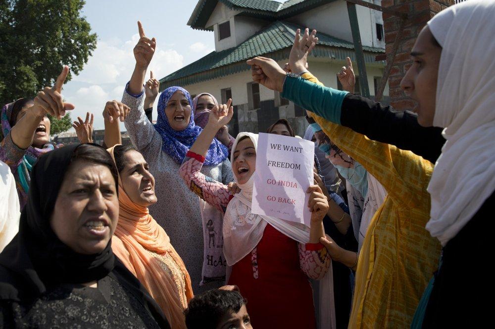 Kashmiri women shout slogans during a protest after Eid prayers in Srinagar on Monday. ─ AP