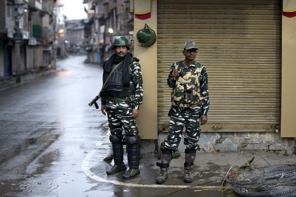 Indian paramilitary soldiers stand guard during security lockdown in Srinagar on Wednesday. ─ AP