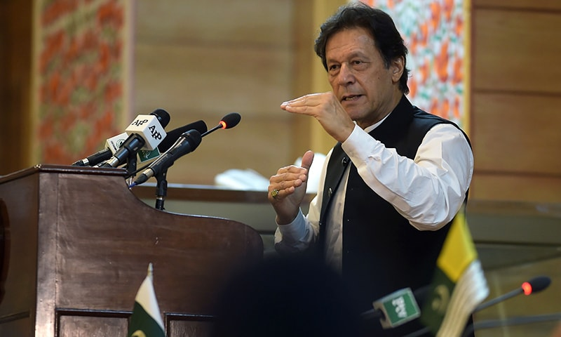 Prime Minister Imran Khan addresses the legislative assembly in Muzaffarabad on August 14 to mark the country's Independence Day. — AFP