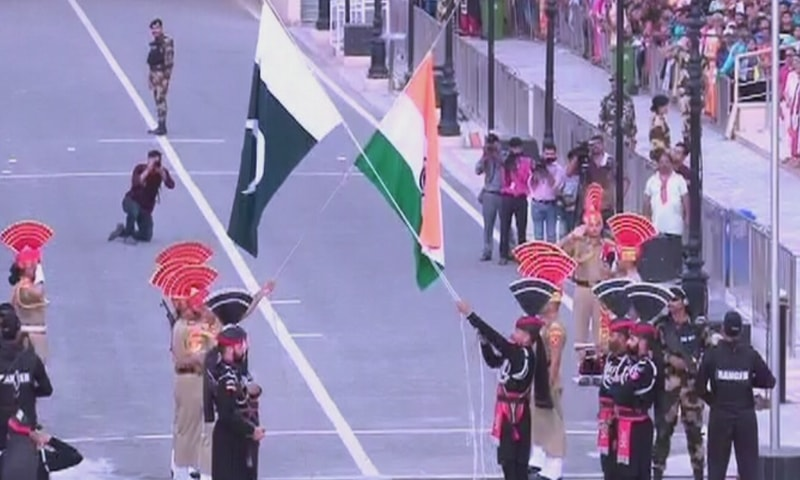 Pakistani and Indian troops take part in a flag-lowering ceremony at the Wagah border. — DawnnewsTV