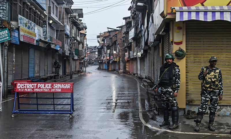 Security personnel stand guard during a lockdown in Srinagar on August 14, after the Indian government stripped occupied Jammu and Kashmir of its autonomy. — AFP