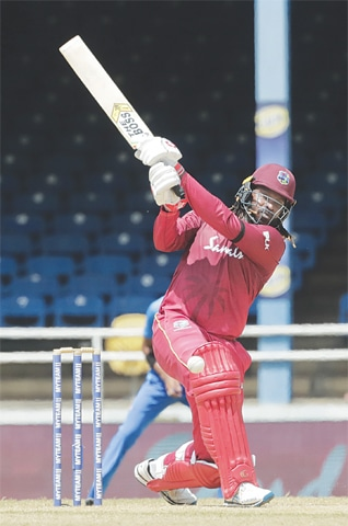 PORT-OF-SPAIN: West Indies opener Chris Gayle hits a boundary during his half-century in the third One-day International against India at the Queen's Park Oval on Wednesday.—AP