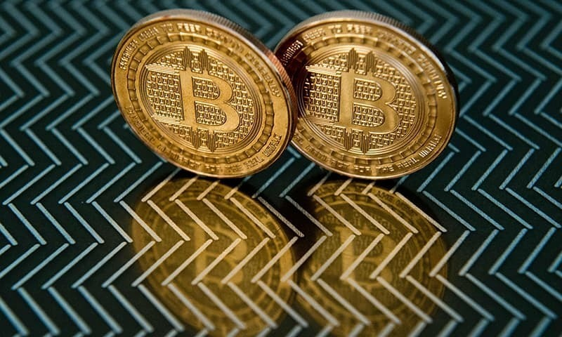 Trade tensions between the United States and China and a weakening Yuan are boosting demand for cryptocurrencies among Chinese investors, market players from Asia to New York said. — AFP/File