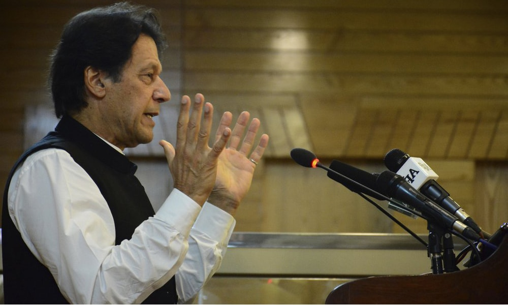 Prime Minister Imran Khan addresses Azad Jammu and Kashmir's legislative assembly on the occasion of Pakistan's Independence Day, in Muzaffarabad, on Wednesday. — AP