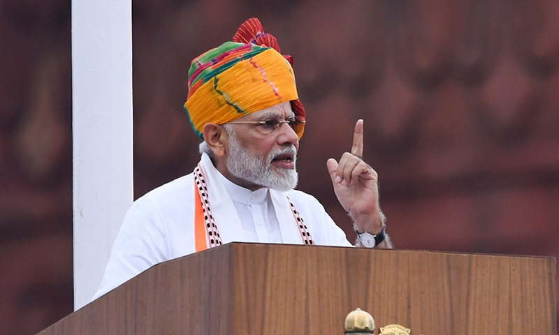 India's Prime Minister Narendra Modi delivers a speech to the nation during a ceremony to celebrate country's Independence Day at the Red Fort in New Delhi on Thursday. — AFP