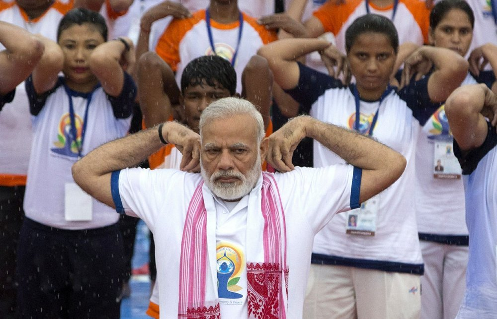 In this 2017 file photo, Indian Prime Minister Narendra Modi, center, performs yoga with thousands of Indians to mark international yoga day in Lucknow, India. ─ AP