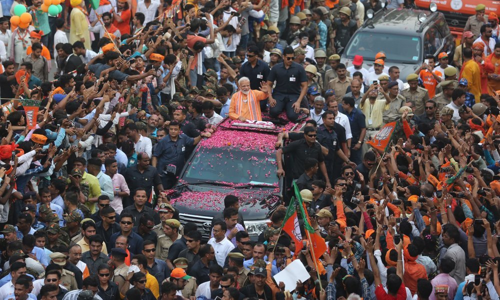 In this April 25, 2019 file photo, Indian Prime Minister Narendra Modi, center, waves to the crowd during a political campaign road show in Varanasi, India. ─ AP