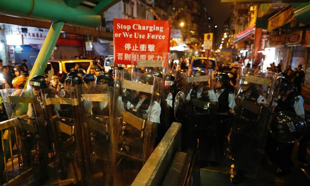 Trump links Hong Kong crisis to trade as China military rallies