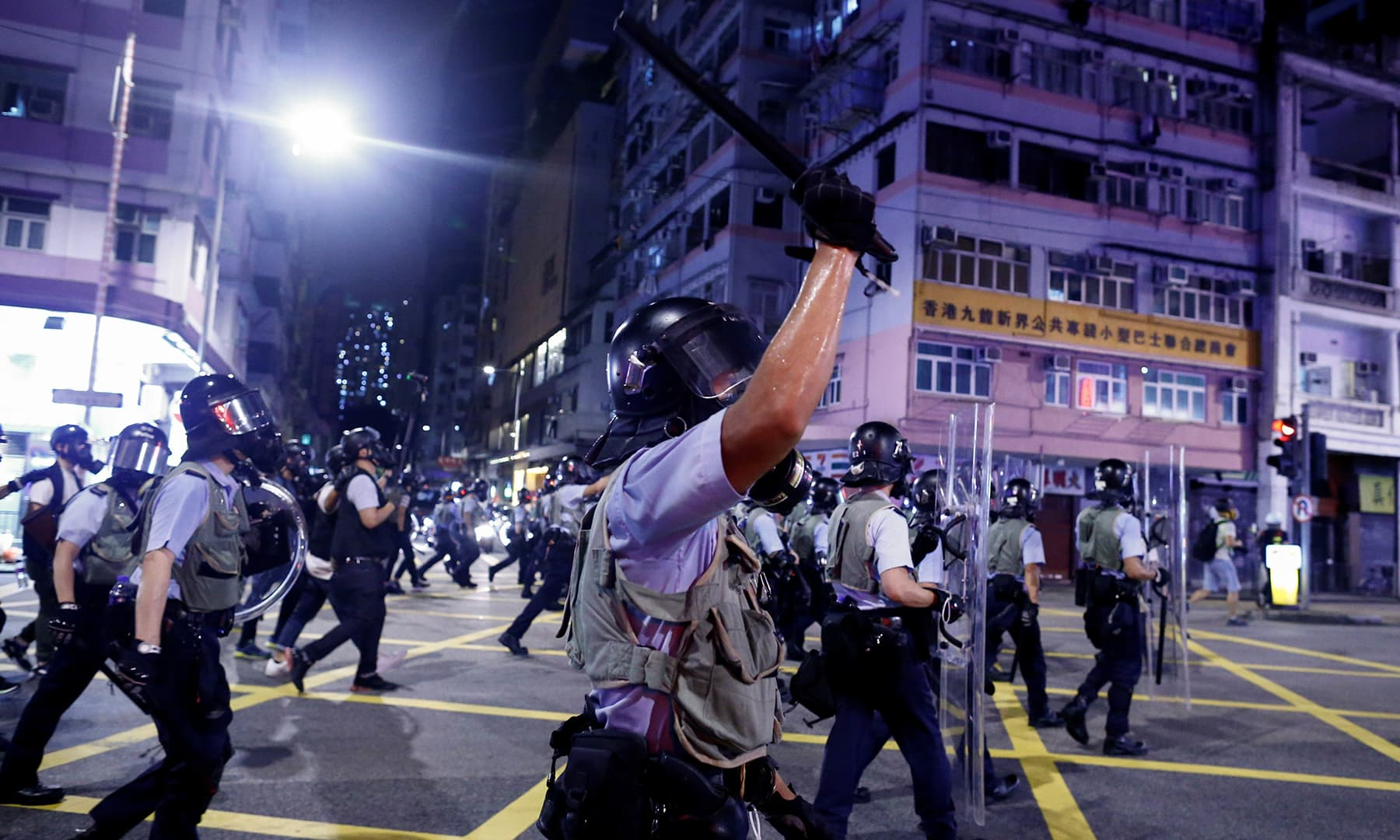 Police advance through the Sham Shui Po neighbourhood during clashes with anti-extradition bill protesters in Hong Kong on Aug 14, 2019. — Reuters