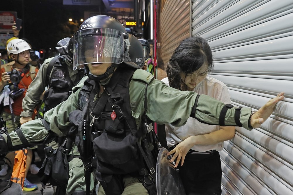 Police detain a girl during a confrontation in Hong Kong on Aug 10, 2019. — AP