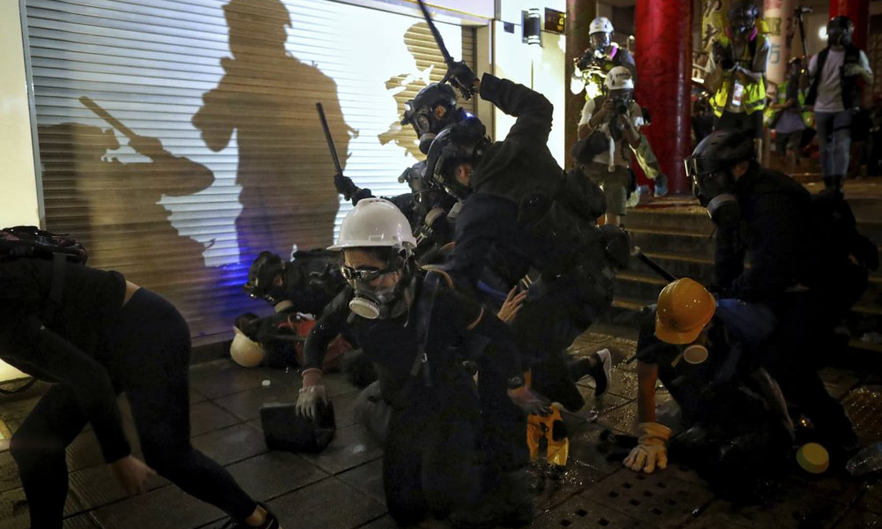 In this Aug 11, 2019, photo, policemen charge towards protesters during the anti-extradition bill protest at Tsim Sha Tsui in Hong Kong. — AP