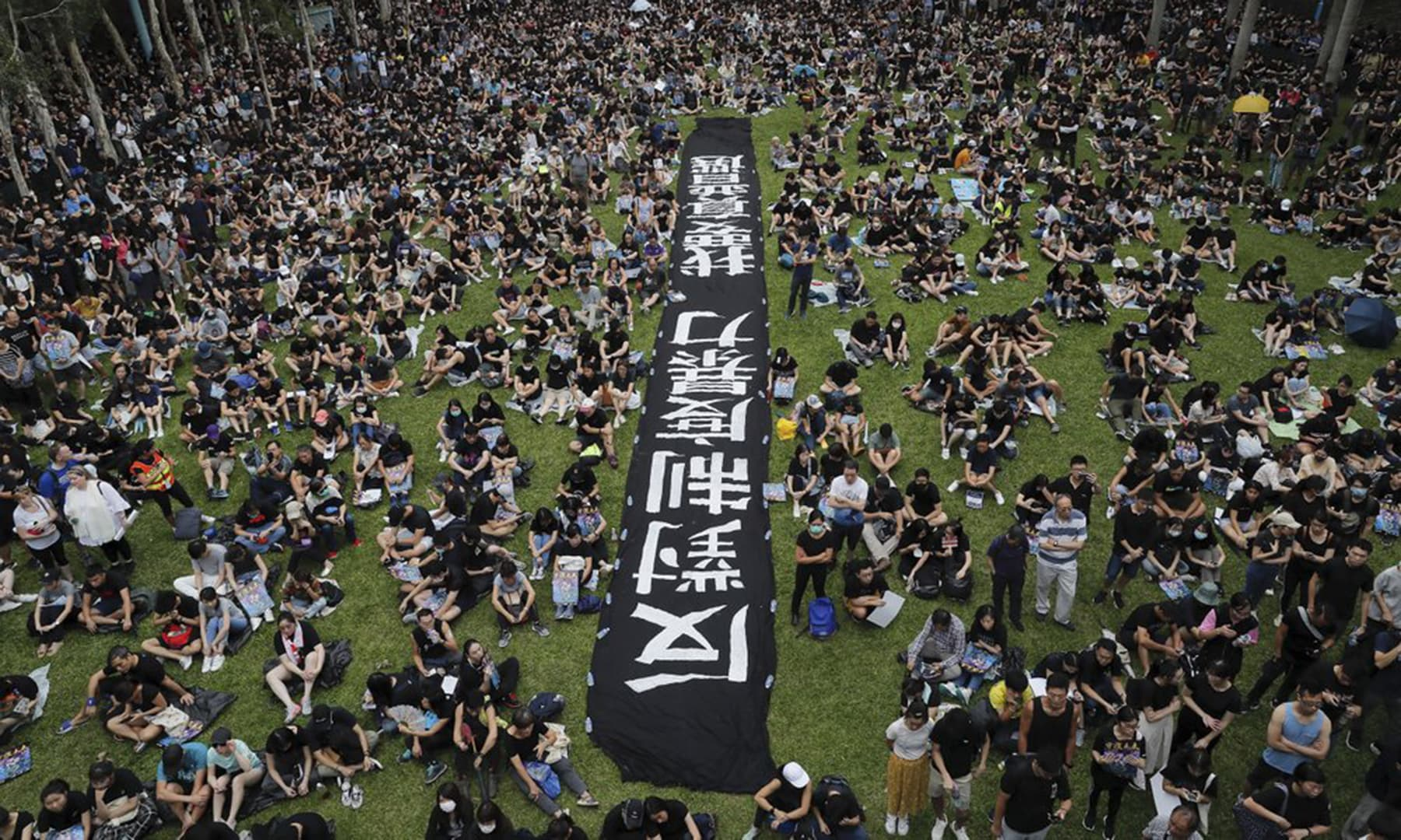 In this Aug 4, 2019, photo, people gather at Belcher Bay Park as they take part in an anti-extradition bill protest in Western district in Hong Kong. — AP