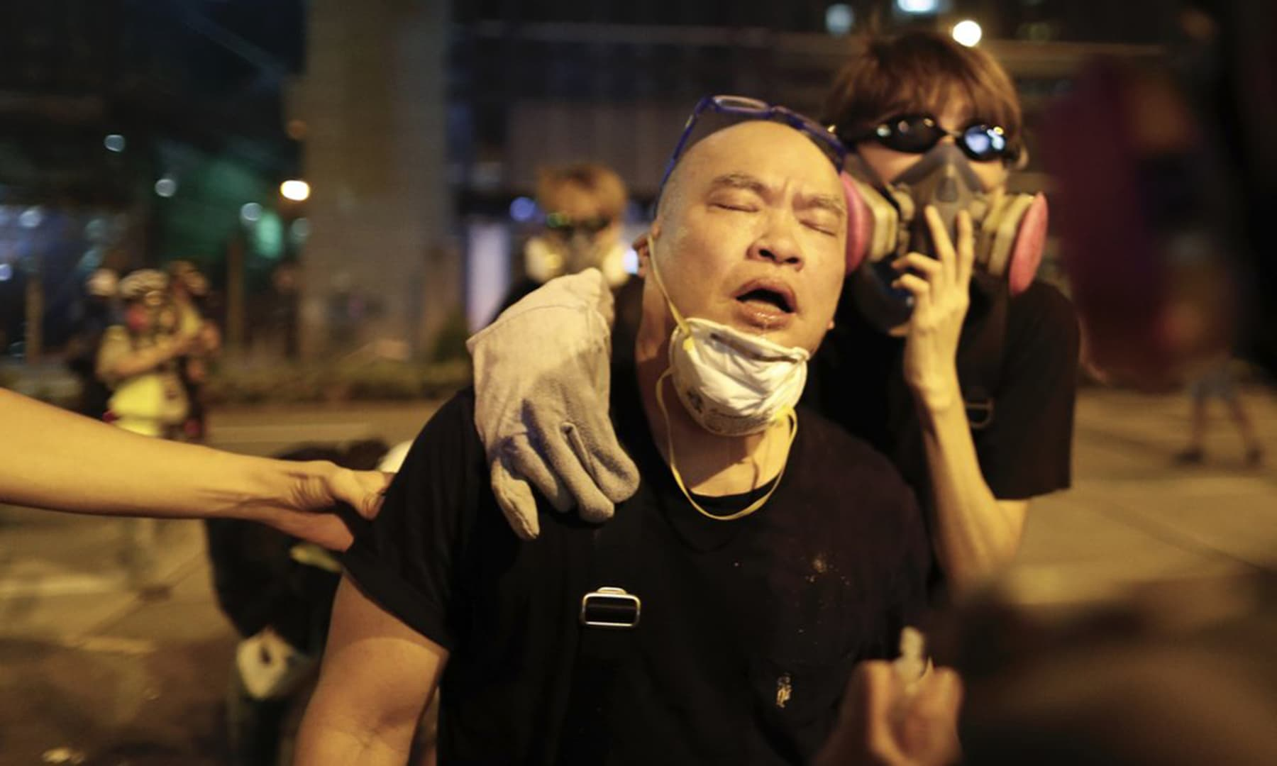 A protester is overcome by tear gas near the Shum Shui Po police station in Hong Kong on Aug 14, 2019. — AP